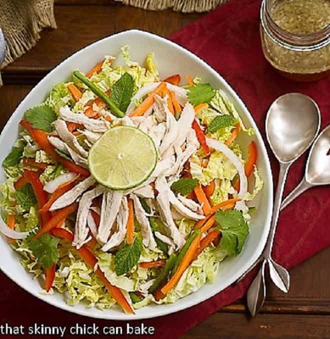 Overhead view of Vietnamese Chicken Salad in a white triangular serving bowl