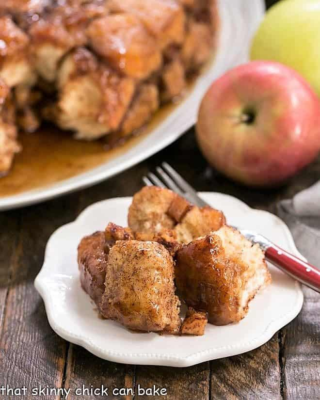 Apple Monkey Bread on a white ceramic plate with a red handled fork