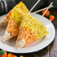 Candy Corn Rice Krispie Treats on skewers on a white plate