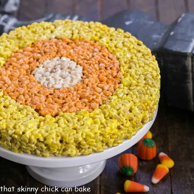 Uncut Candy Corn Rice Krispie Treats on a cake stand