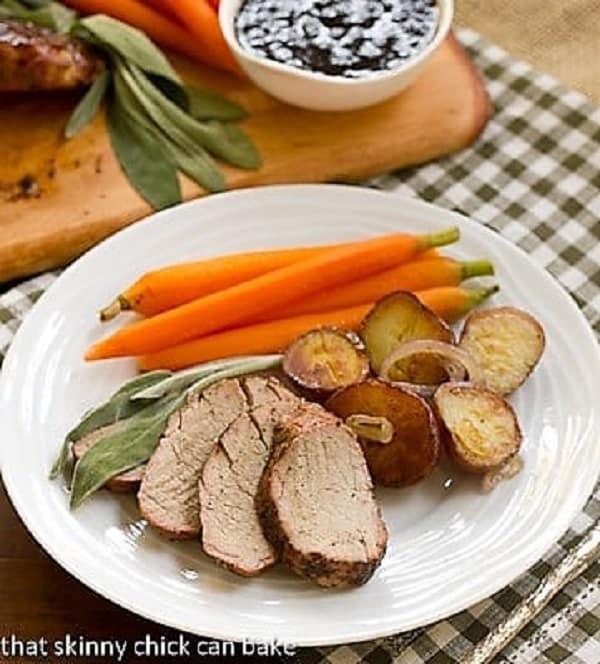 Sliced Grillled Pork tenderloin on a white dinner plate