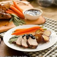 Grilled pork with plum sauce fanned out on a dinner plate