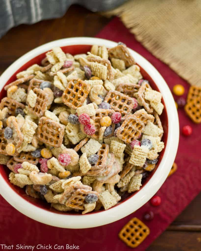 white chocolate monster munch om a ceramic bowl on a red napkin - Christmas Chex Mix White Chocolate