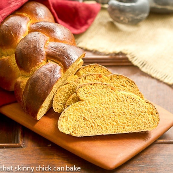 Pumpkin Challah slices on a wooden cutting board