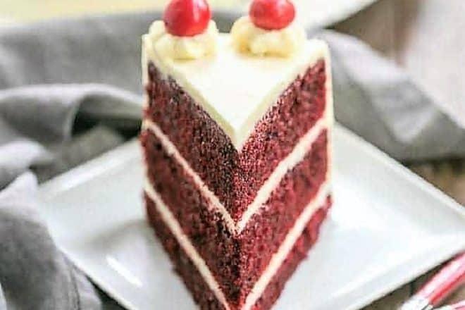 Red velvet cake slice on a square white plate