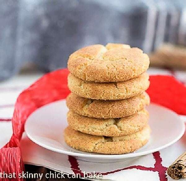 Stack of brown butter snickerdoodles on a white ceramic plate