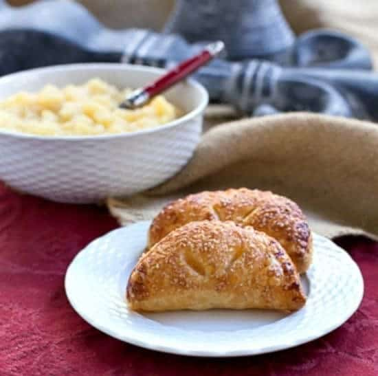 Compote de Pommes or French Applesauce in a bowl and as filling in two apple turnovers