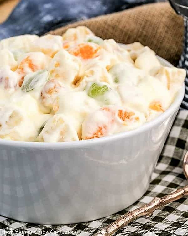 Holiday Fruit Salad with Marshmallows in a white ceramic bowl