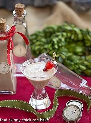 Homemade Baileys Irish Cream in a martini glass with a cherry garnish