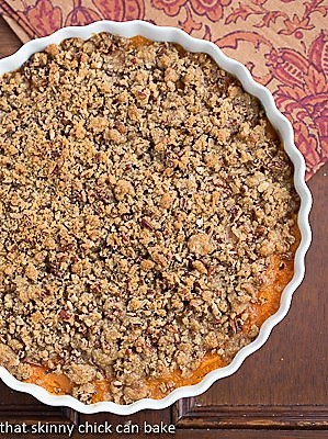 Overhead view of Praline Topped Sweet Potato Casserole in a white, round casserole dish
