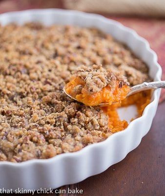 Praline Topped Sweet Potato Casserole in a white ceramic dish