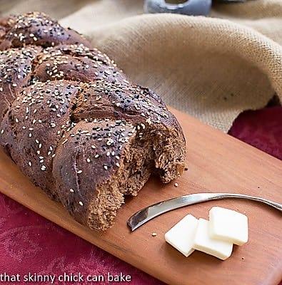 Pumpernickel Loaves on a wooden cutting board