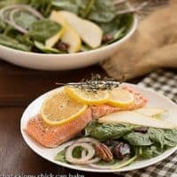 Salmon Fillets en Papillote with a salad on a dinner plate