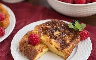 Sugar crusted French toast halves on a white plate