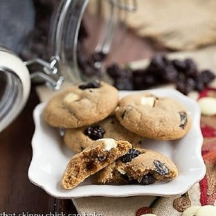 Biscoff Cookies with Dried Cherries and White Chocolate Chunks piled on a small white plate