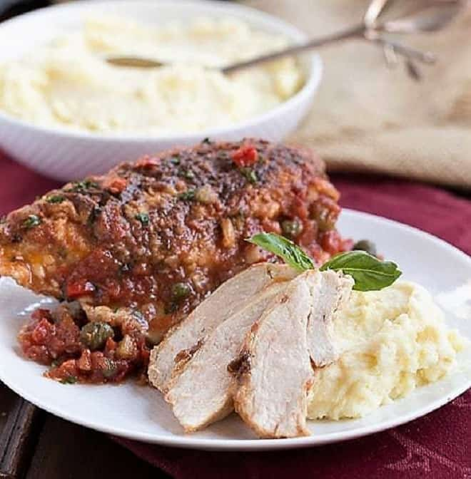 Chicken_Cacciatore on a plate with mashed potatoes