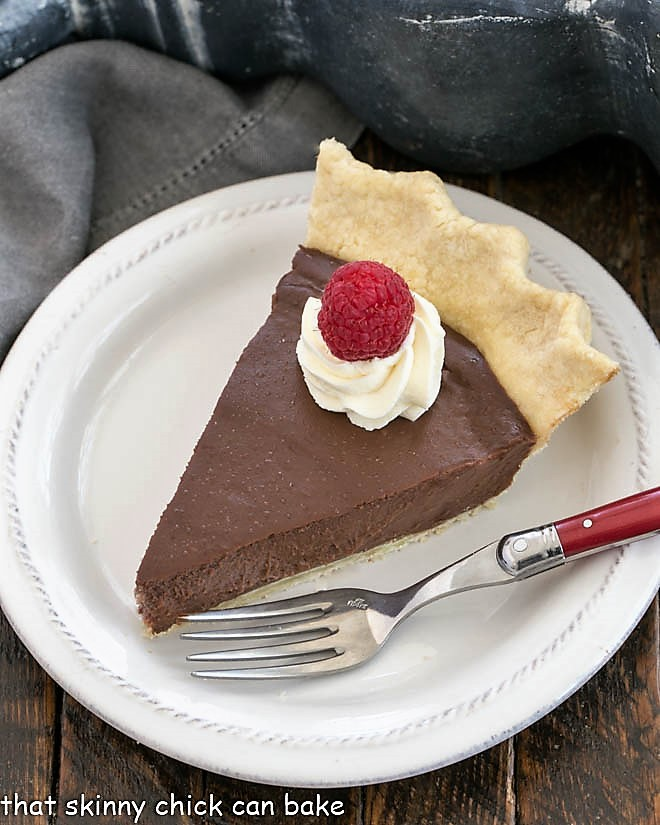Slice of pdding pie on a white dessert plate