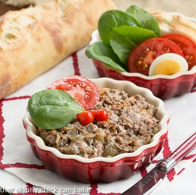 Chopped Liver with Quatré-Epices in red ceramic dishes