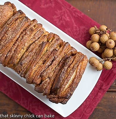 Overhead view of a Cinnamon Pull Apart Coffee Cake on a white platter