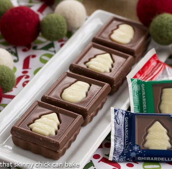 Festive Fudge Snowflakes and Squares on a white rectangular tray