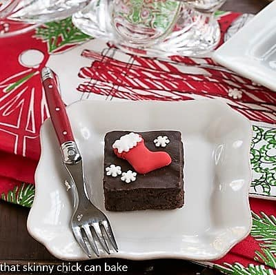 Plated Fudgy red wine brownies with holiday garnishes