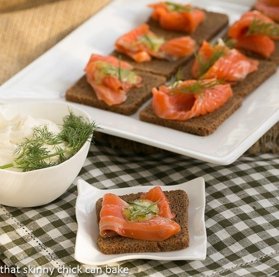 Dilled Gravlax with Mustard Sauce  on rye cocktail bread with a dill garnish