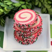 Holiday Pinwheel Cookies stacked on a square white plate