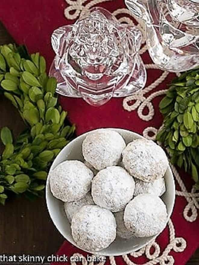 Overhead view of a bowl of Noel Nut Balls on a holiday table