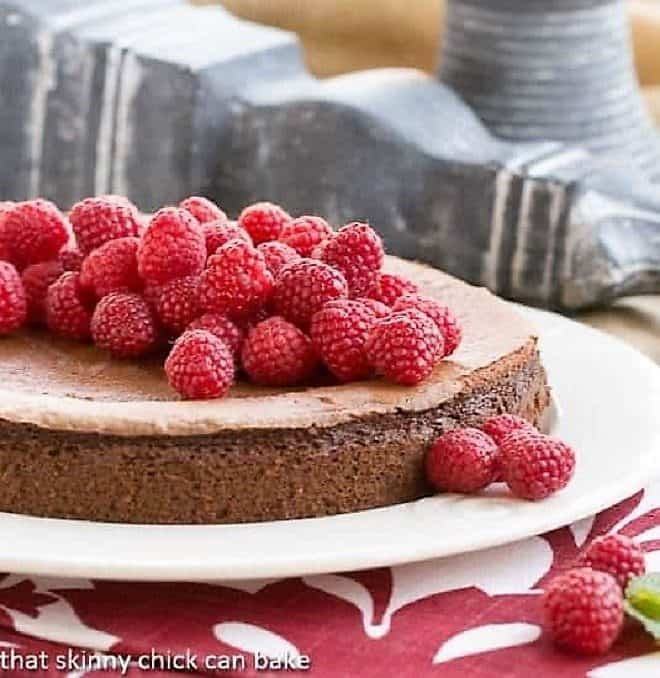 Chocolate Mousse Torte covered with fresh raspberries