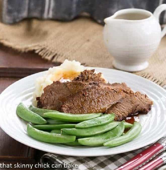 Coffee Blazed Brisket slices on a white dinner plate