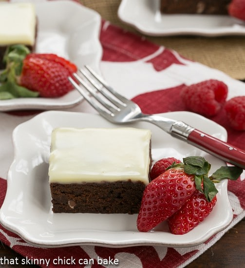 Quintuple Chocolate Brownies on a white plate with strawberries