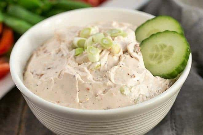 Sun-dried tomato dip garnished with cucumbers