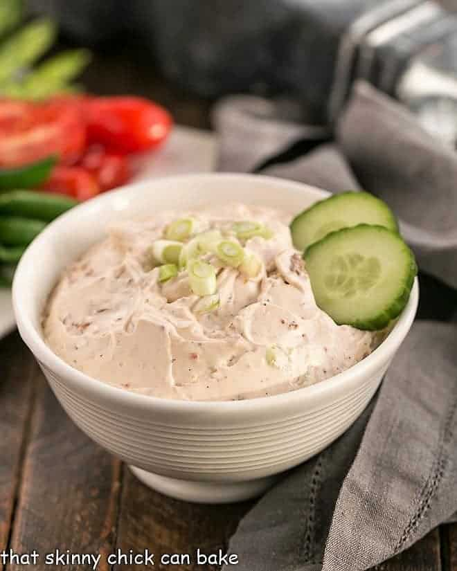 Sun-dried Tomato Dip with garnish of green onions and cucumbers