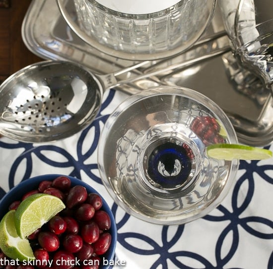 White Cosmopolitans from above with a bowl of garnishes