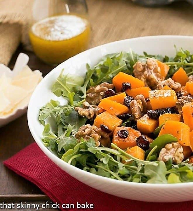 Arugula Salad with Roasted Butternut Squash in a white serving bowl