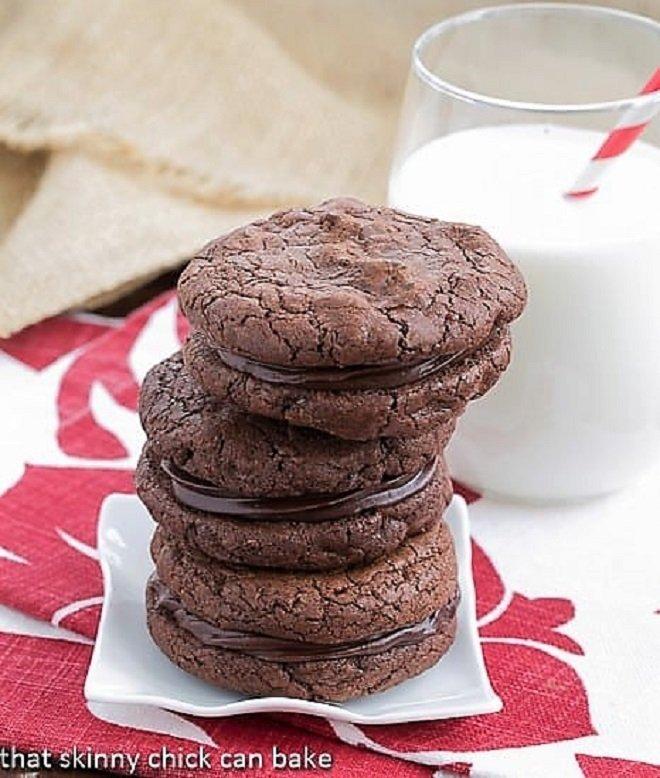 Stack of chocolate sandwich cookies on a small white plate