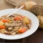 French Garbure Stew in a white soup bowl
