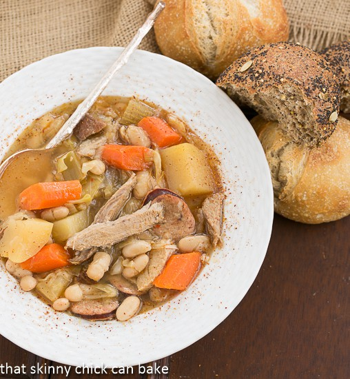 French Garbure Stew overhead shot with dinner rolls