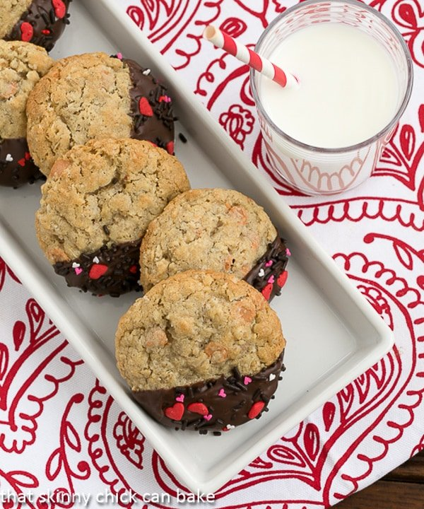 Overhead shot of Big Dipper Oatmeal Butterscotch Cookies on a red and white napkin with a glass of milk