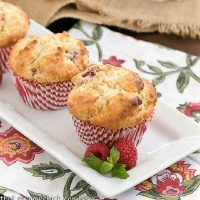 Spectacular Raspberry White Chocolate Muffins on a white rectangular platter