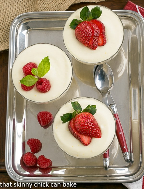 Dreamy White Chocolate Mousse spiked with Frangelico in glass parfait dishes on a silver tray
