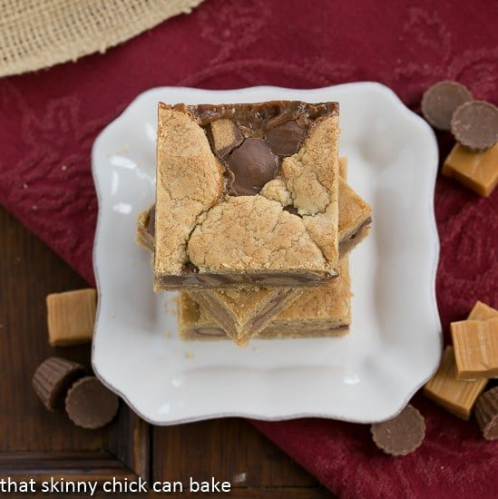 Chocolate Peanut Butter Bars | Rich peanut butter and chocolate bars with a layer of caramel and peanut butter cups