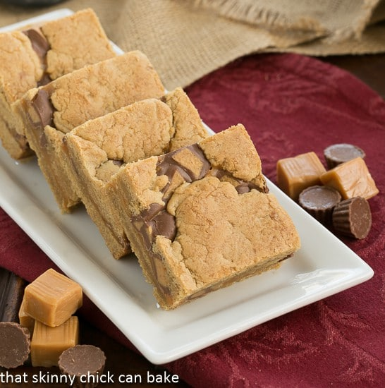 Chocolate Peanut Butter Bars lined up on a white tray