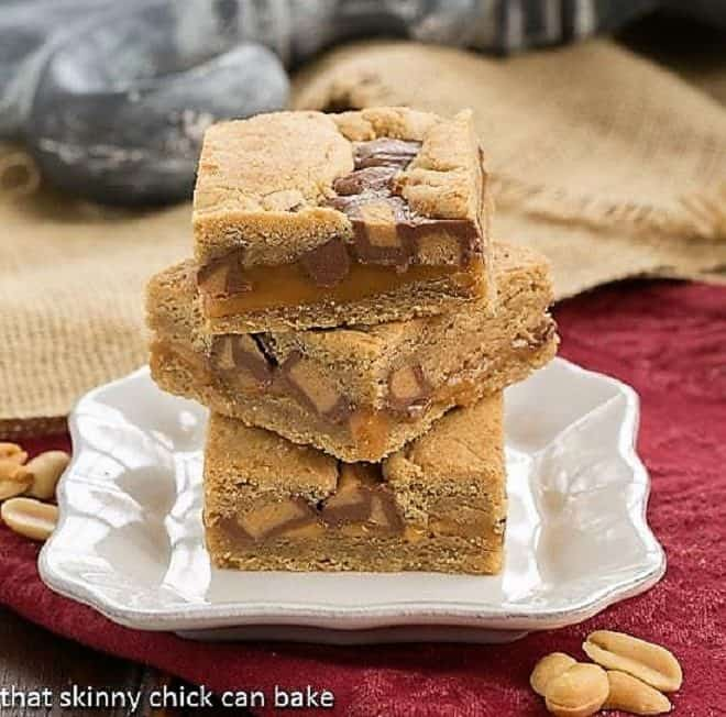 Chocolate Peanut Butter Bars stacked on a white plate