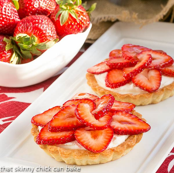 Fresh Strawberry Tartlets with a bowl of berries