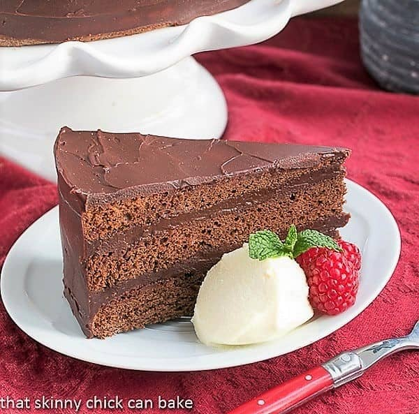 Slice of Mocha Brownie Cake on a white dessert plate