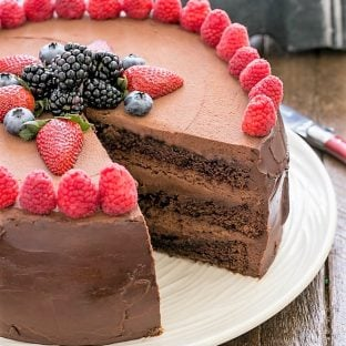Layered chocolate mousse cake with a slice removed