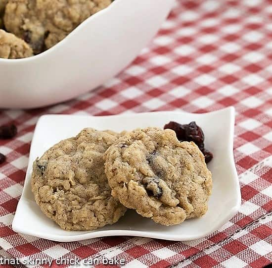 Oatmeal Craisin Cookies on a small white plate over a checked napkin