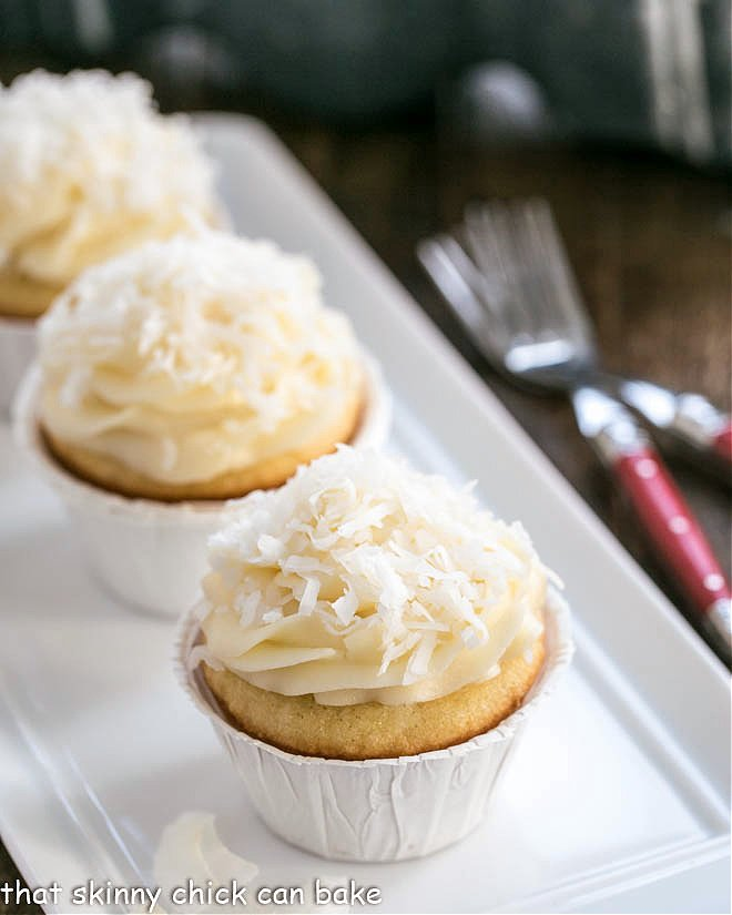 Coconut cupcakes on a white tray