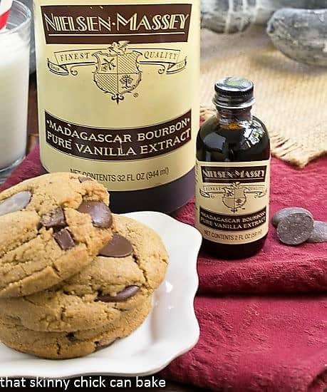 Jumbo Chocolate Chip Cookies in front of two bottles of vanilla